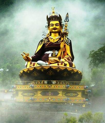 Statue of Guru Rinpoche in mist