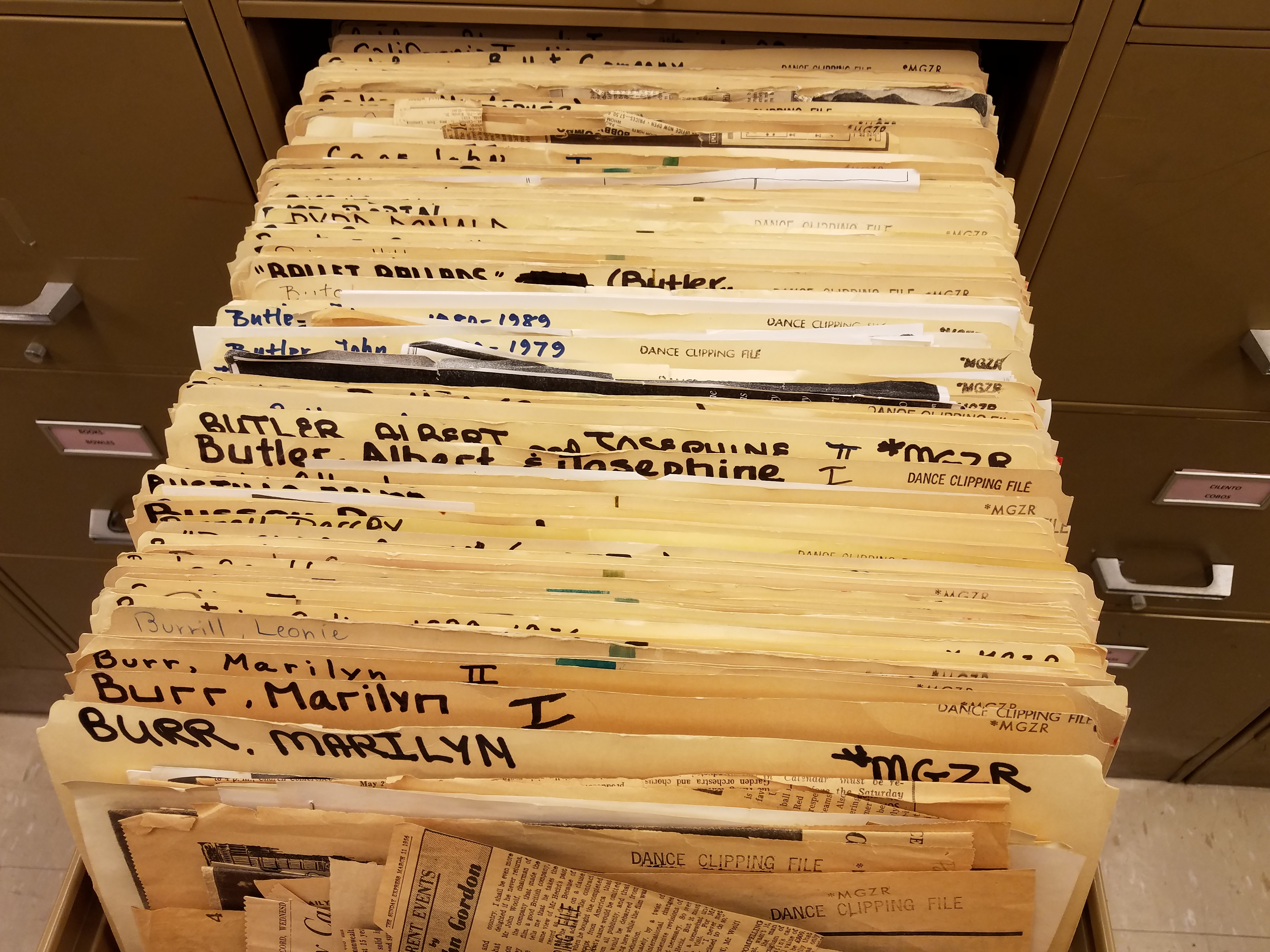 Dance clipping files in drawer