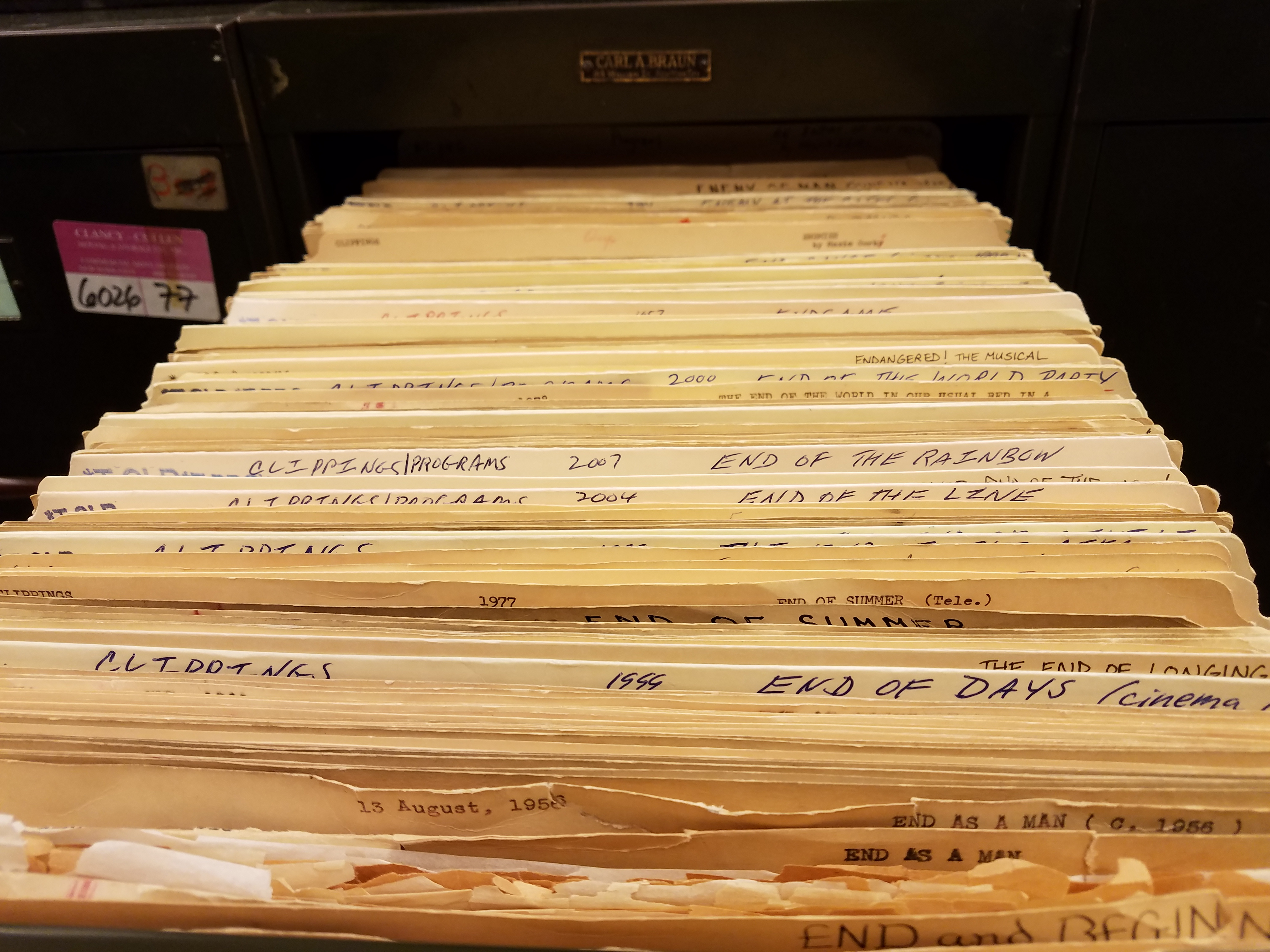 A drawer of clipping file folders from the Theatre Division
