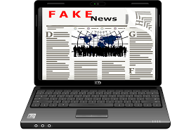 "Image of computer laptop showing a made-up website with headline reading ""fake news"""
