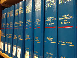 Print Volumes of West's Legal Forms on the shelf.