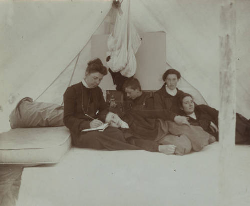 Photo of Hill with her children in a tent.