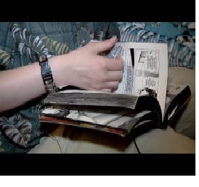 Flipping a book on hand