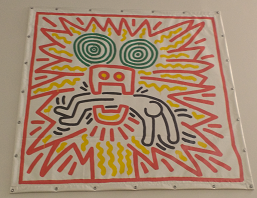 Keith Haring painting Untitled. This painting is on the wall in the Cohen Library.