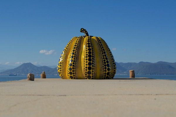 a sculpture representing a pumpkin, modern art in Naoshima.