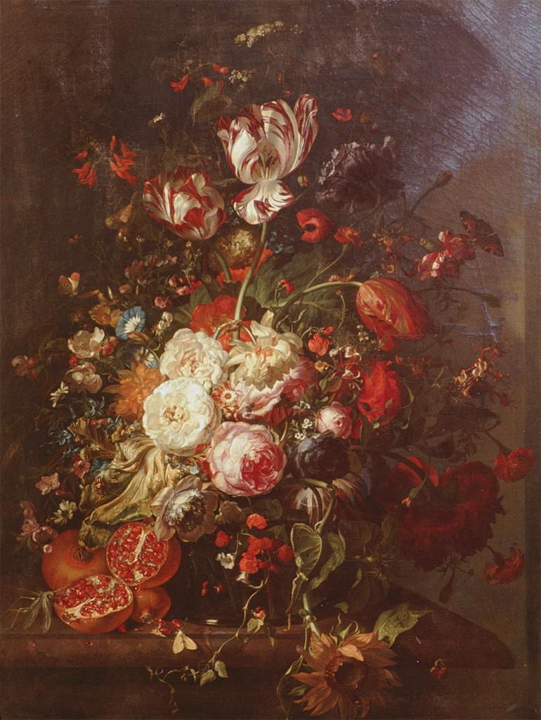 Still Life of a large bouquet of flowers, near the bottom some are dying and there are also pomegranates.