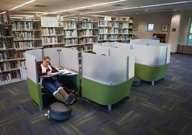 Study carrels with student studying