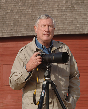 Picture of Jim Argo with camera on tripod