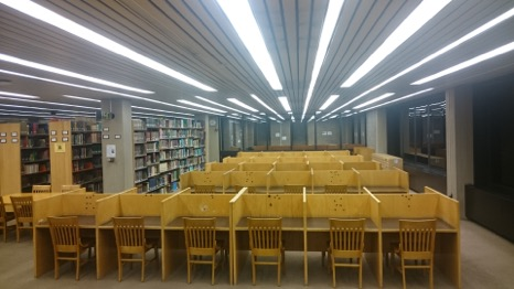 Photo of study area in library with unoccupied tables and chairs