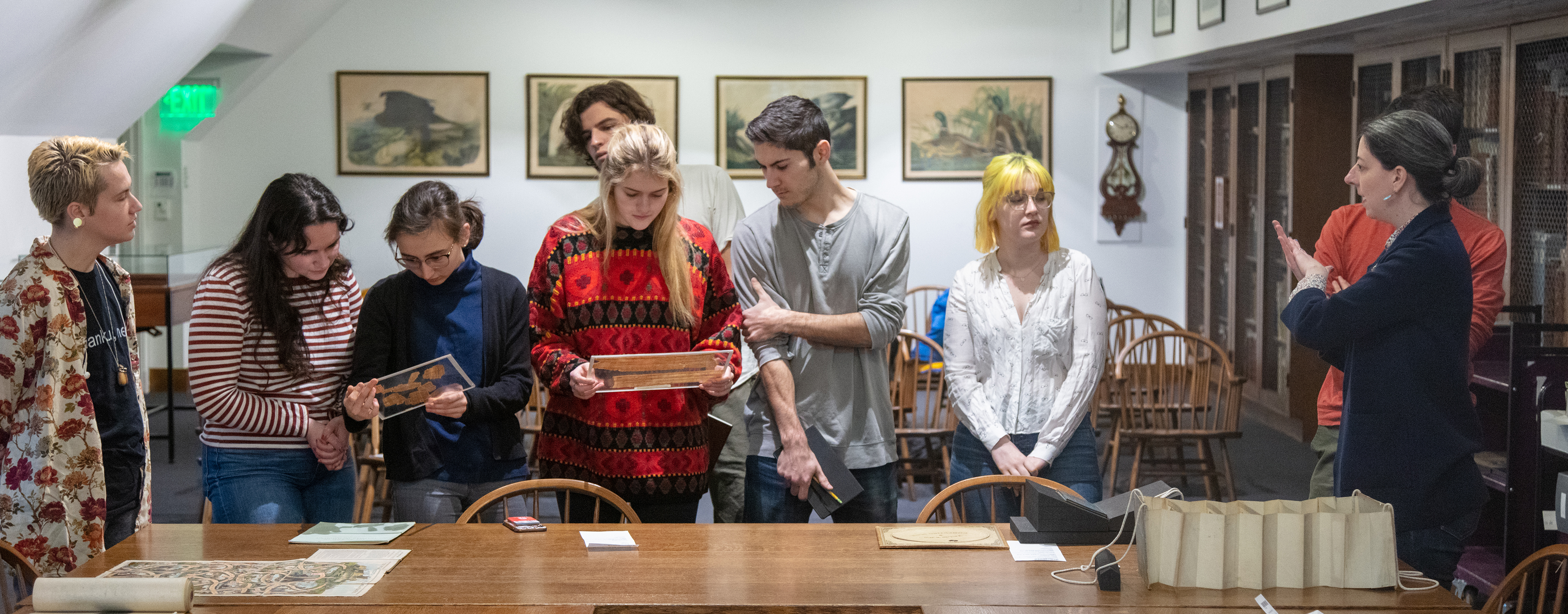 Students in the John Hay Library examine Egyptian papyri and other artifacts.