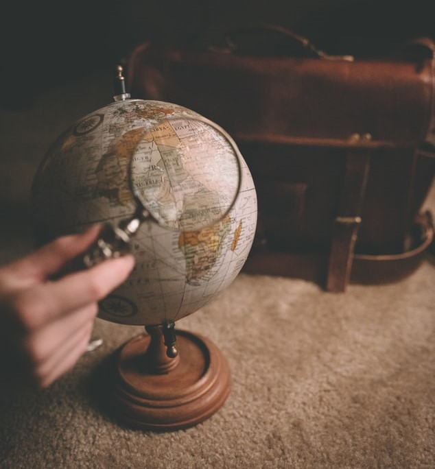 magnifying glass held over a globe