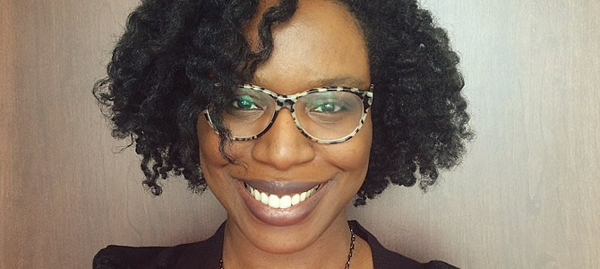 author profile, a smiling Black woman in glasses with chin length natural hair