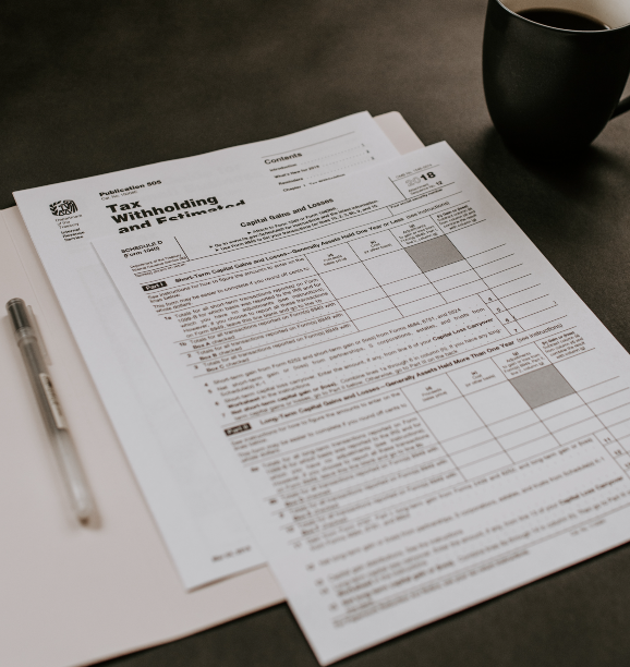 An open folder containing tax forms.