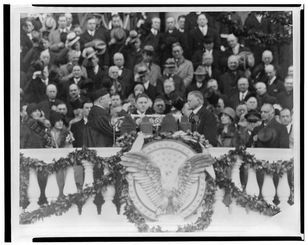 [Chief Justice William H. Taft administering the oath of office to Herbert Hoover on the east portico of the U.S. Capitol, March 4, 1929]