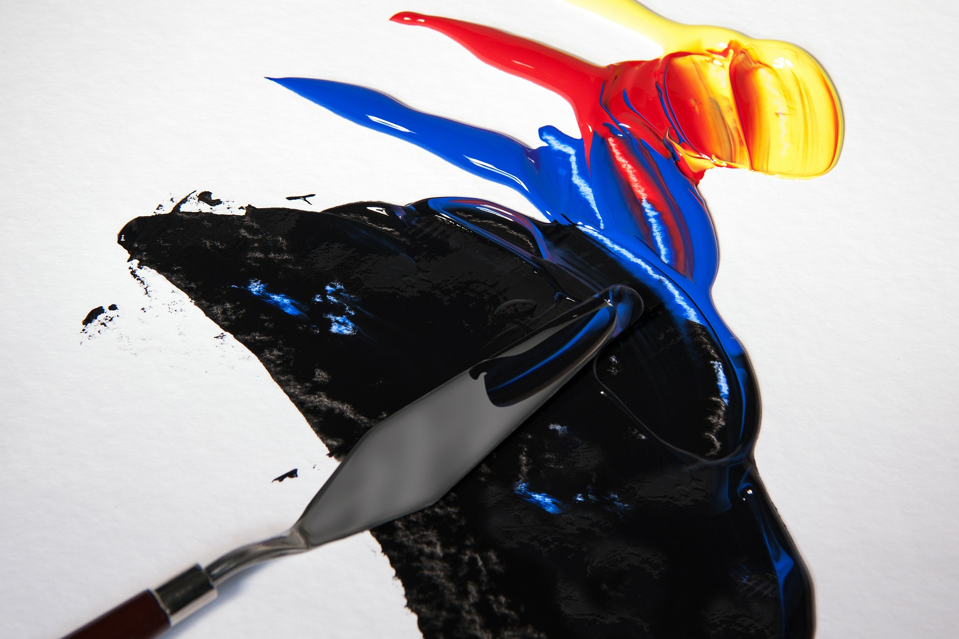 Decorative image of different colors of acrylic paint being blended together.
