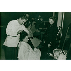 Photograph of a women getting a haircut.