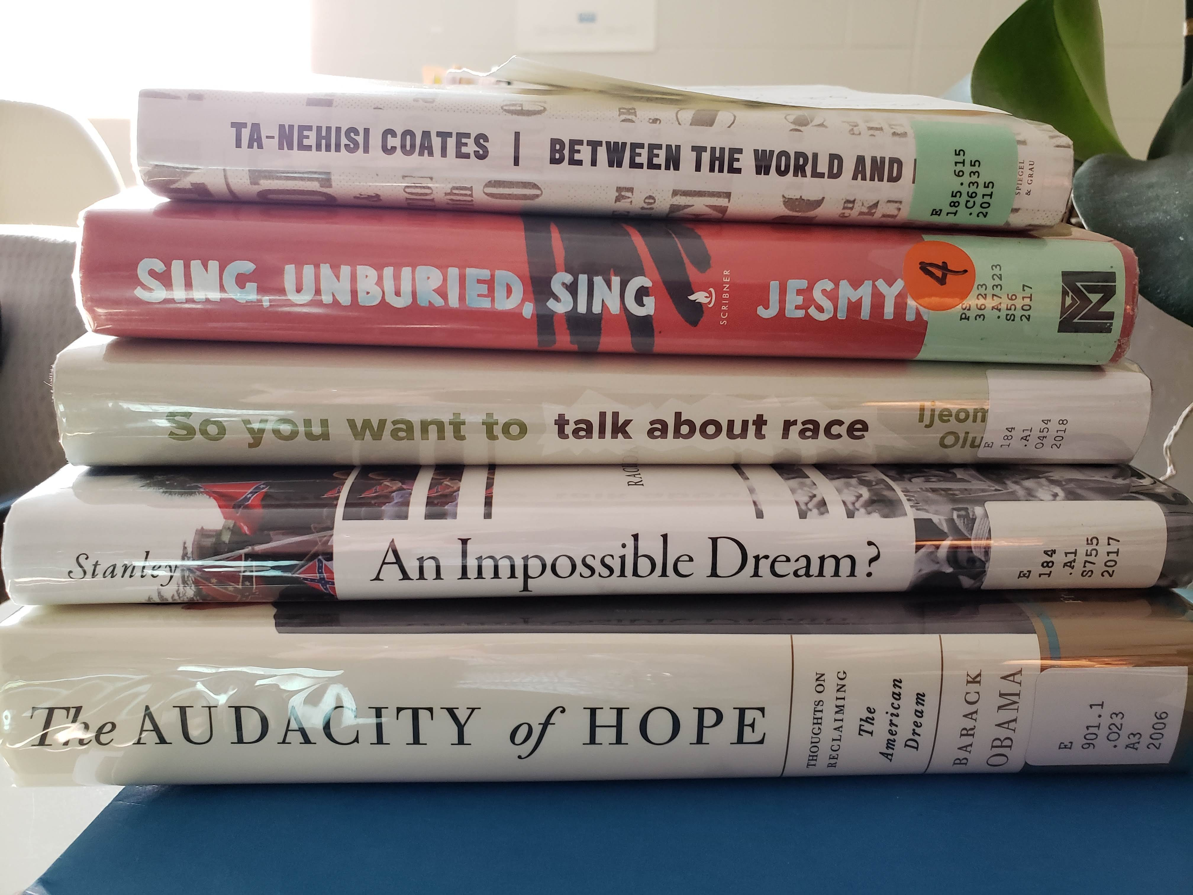 stack of books about race