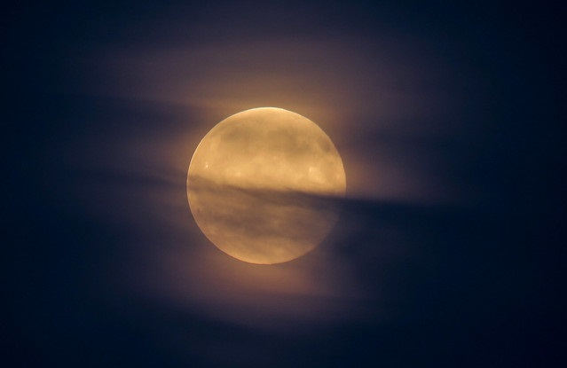moon with misty clouds in front