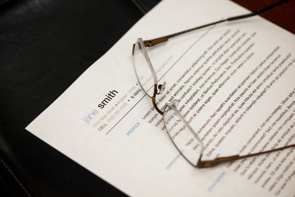 paper resume with glasses