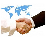 image of handshake in front of world map