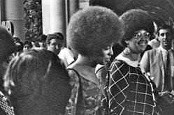 Angela Davis enters Royce Hall for first lecture, October 7, 1969