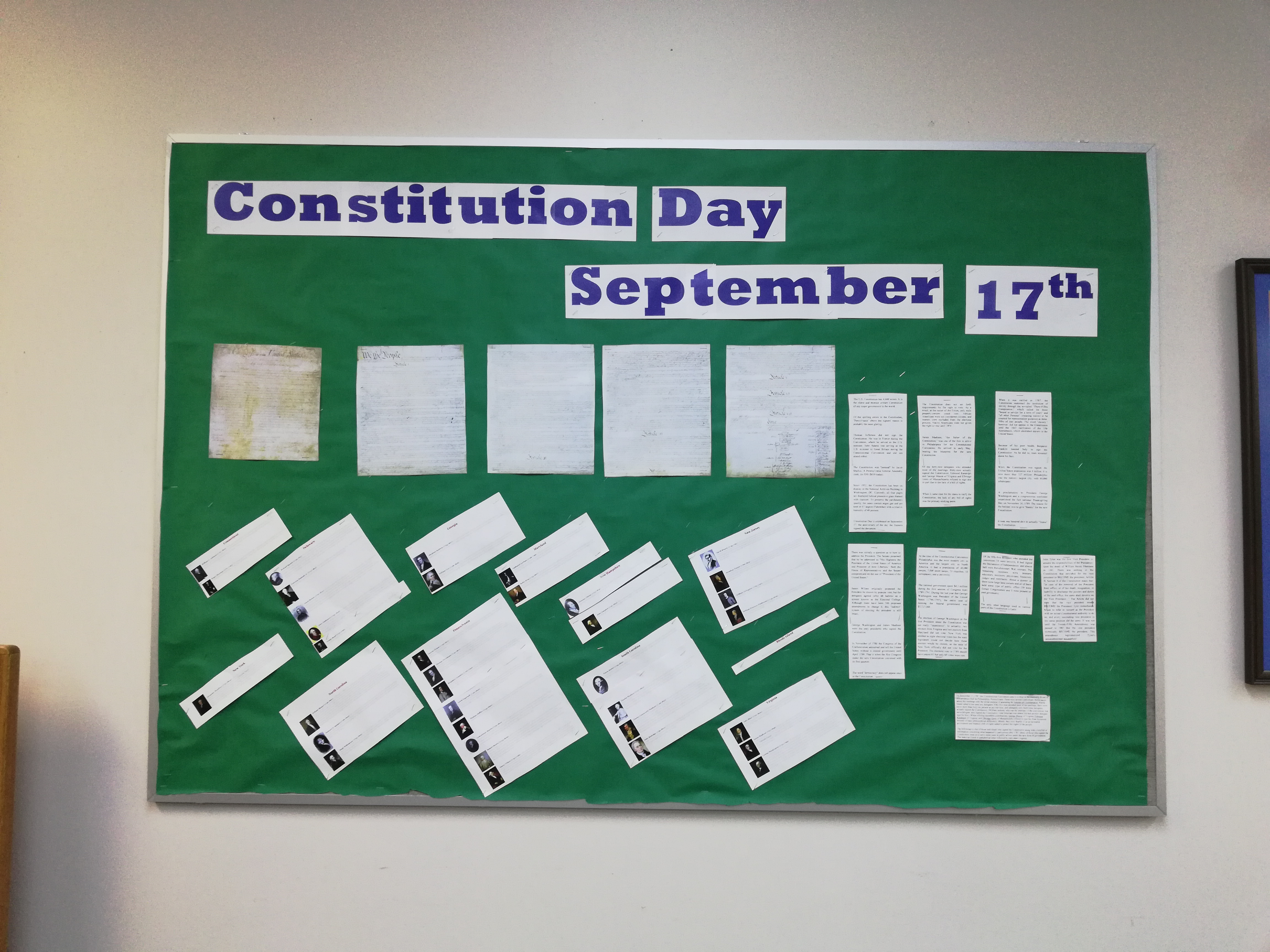 """Constitution Day and Citizenship Day is observed each year on September 17 to commemorate the signing of the Constitution on September 17, 1787, and """"recognize all who, by coming of age or by naturalization, have become citizens."""" Green background with blue lettering with copies of the constitution"""