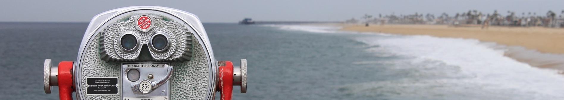 decorative image of binoculars looking at the sea