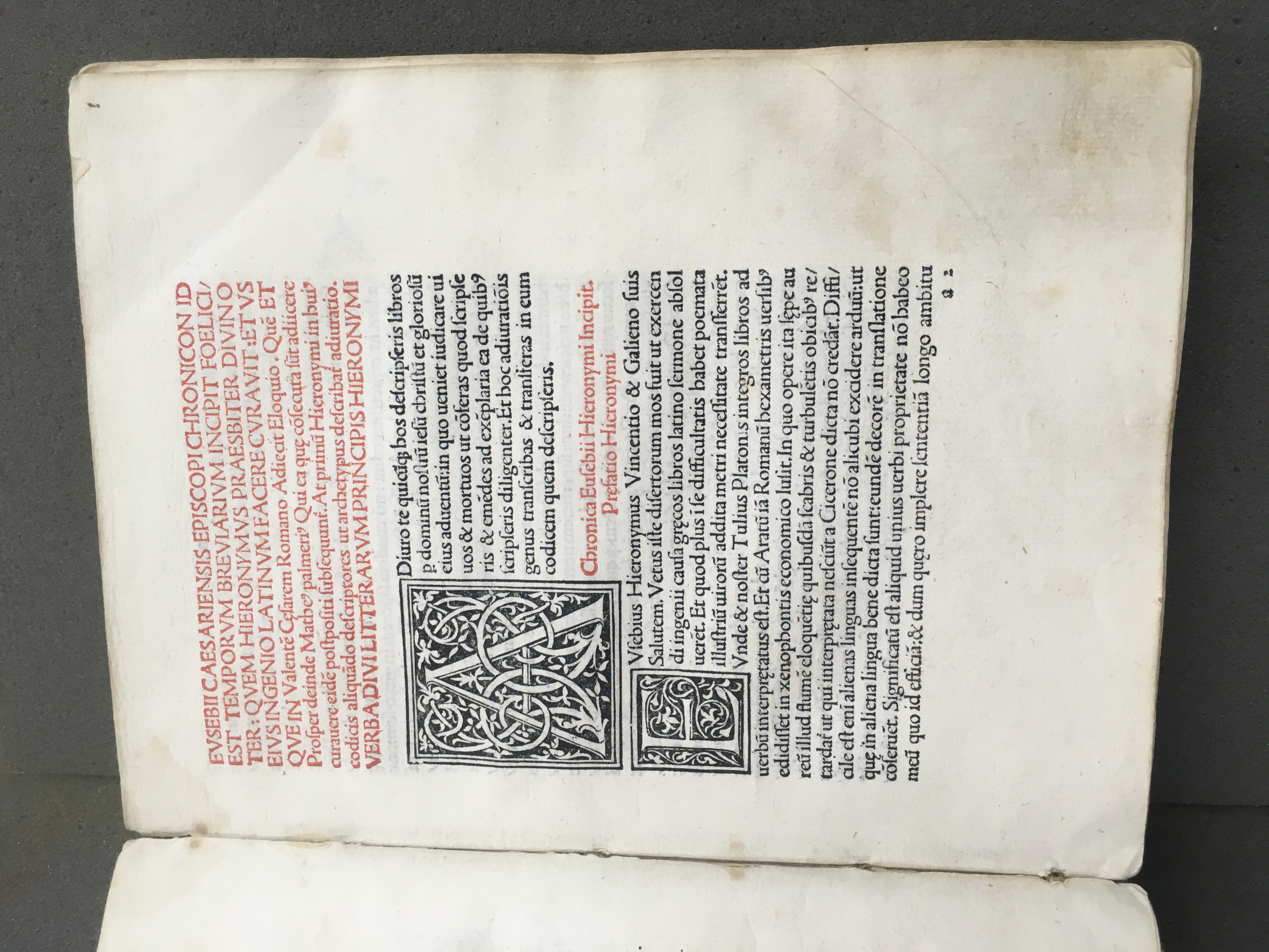 Opening page of the Chronicon showing elaborate initial letters A and E and black and red text.