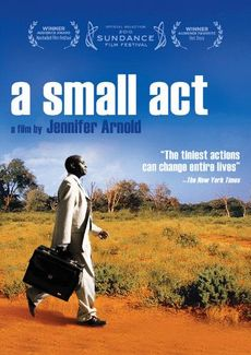 Video cover for movie titled A Small Act. Cover features a business man walking across an orange dirt field with some tufts of grass with a bright blue sky as the background and the title of the movie in white against the sky.