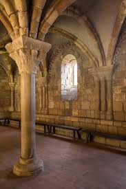 Image of a column and ceiling with buttresses in the NY Met Cloisters