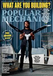 Cover of Popular Mechanics Magazine featuring man holding a propeller.