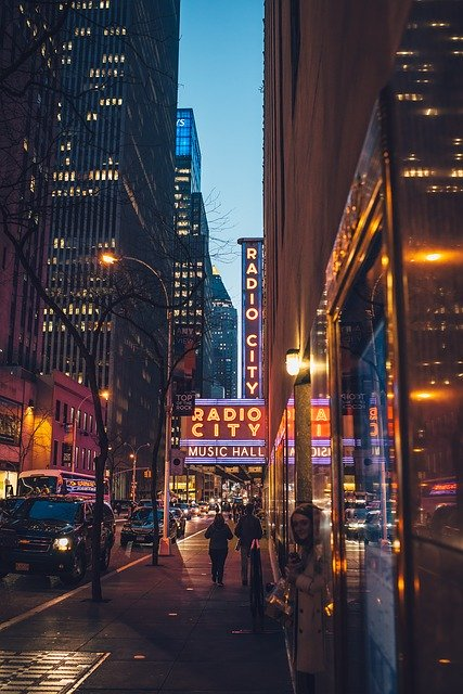 Photograph of the buildings on Broadway St in New York City including a sign for Radio City