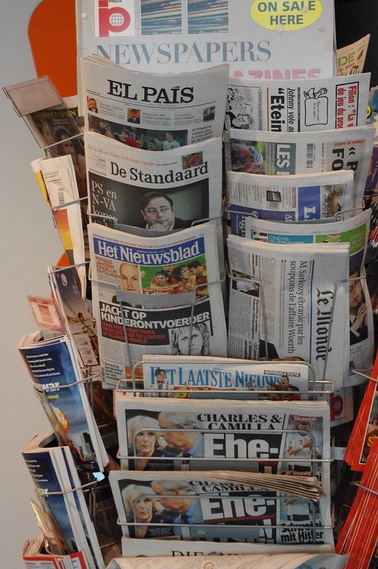 a stand full of newspapers