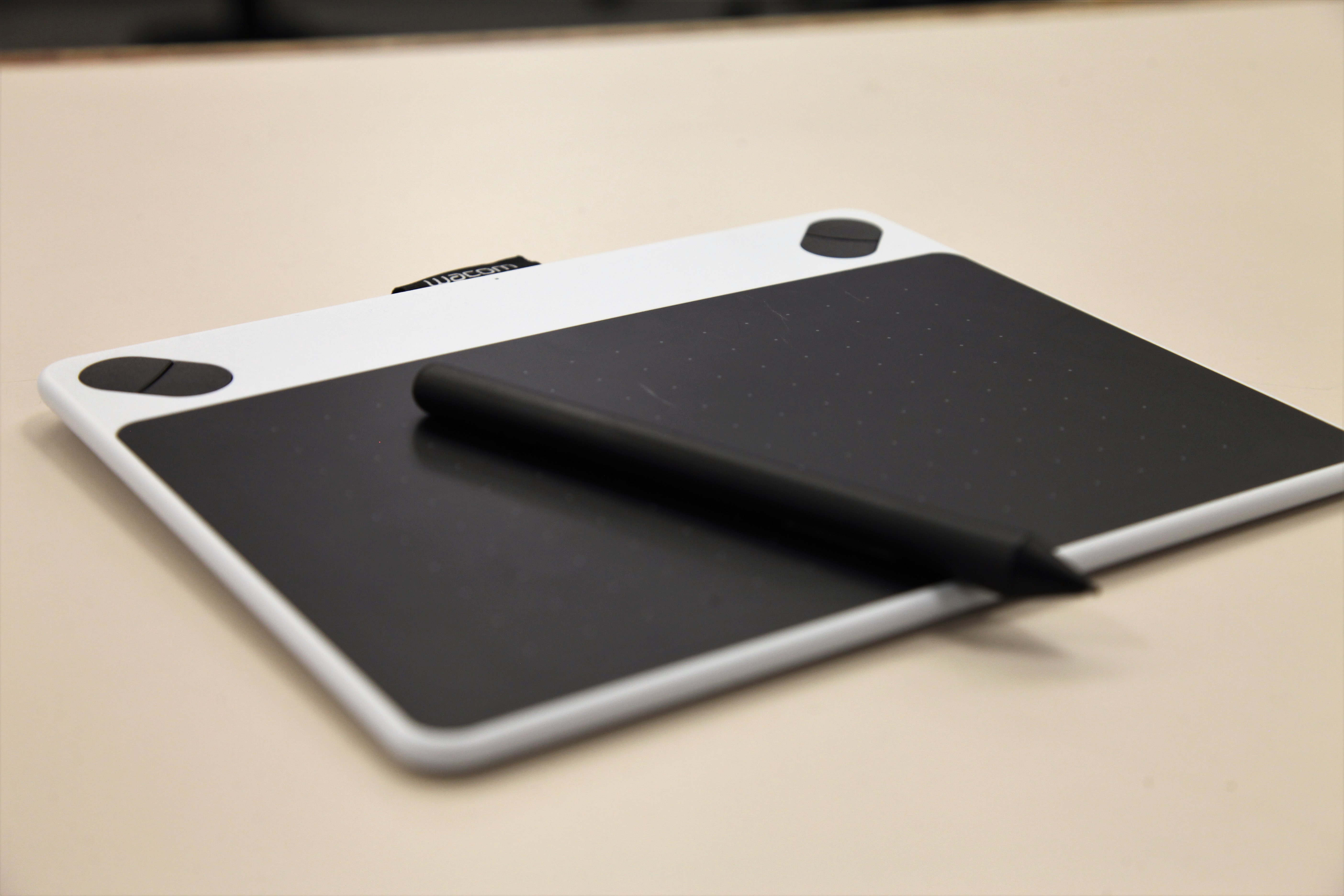 A Wacom Drawing Tablet and a stylus on a counter