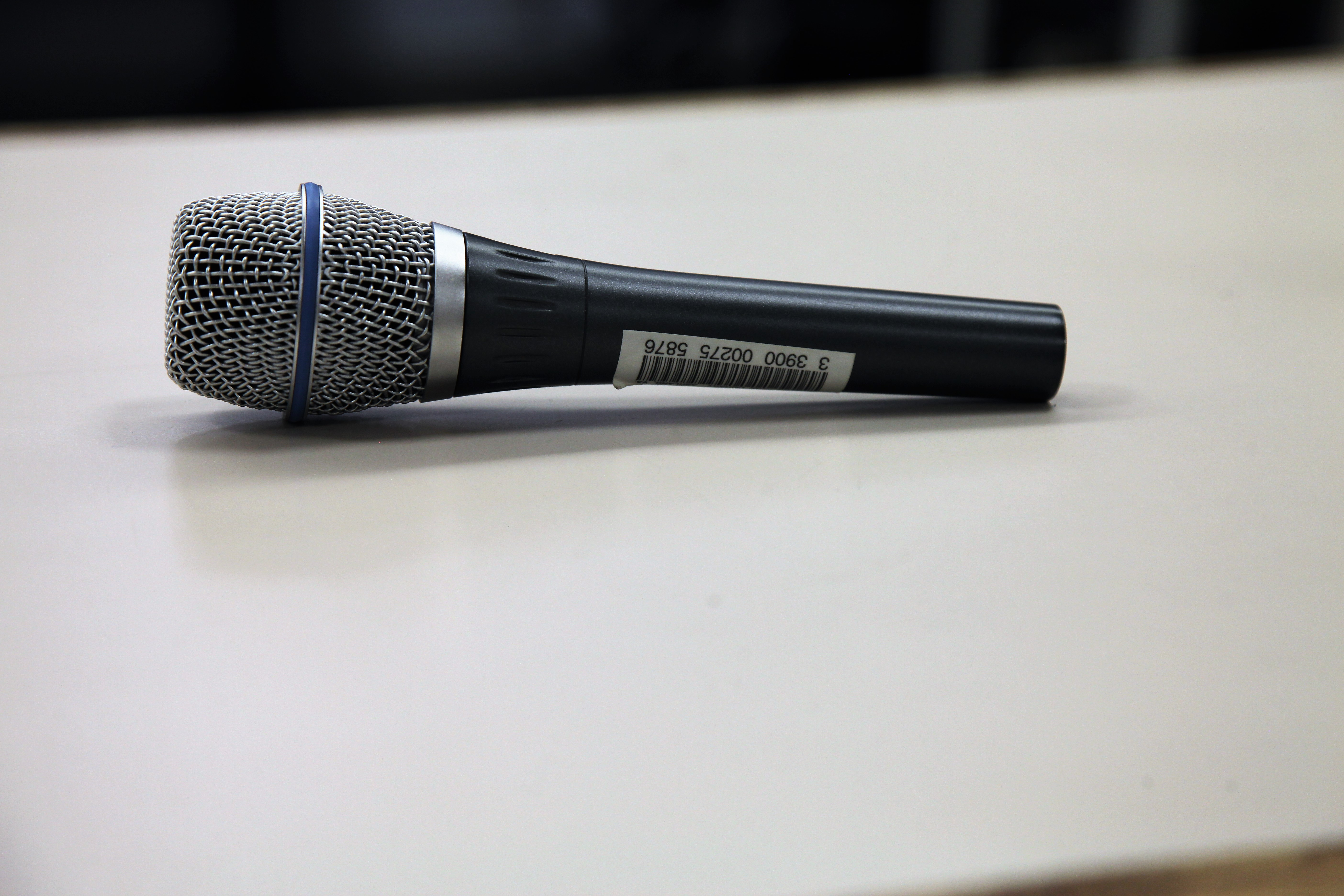 a handheld microphone on a counter