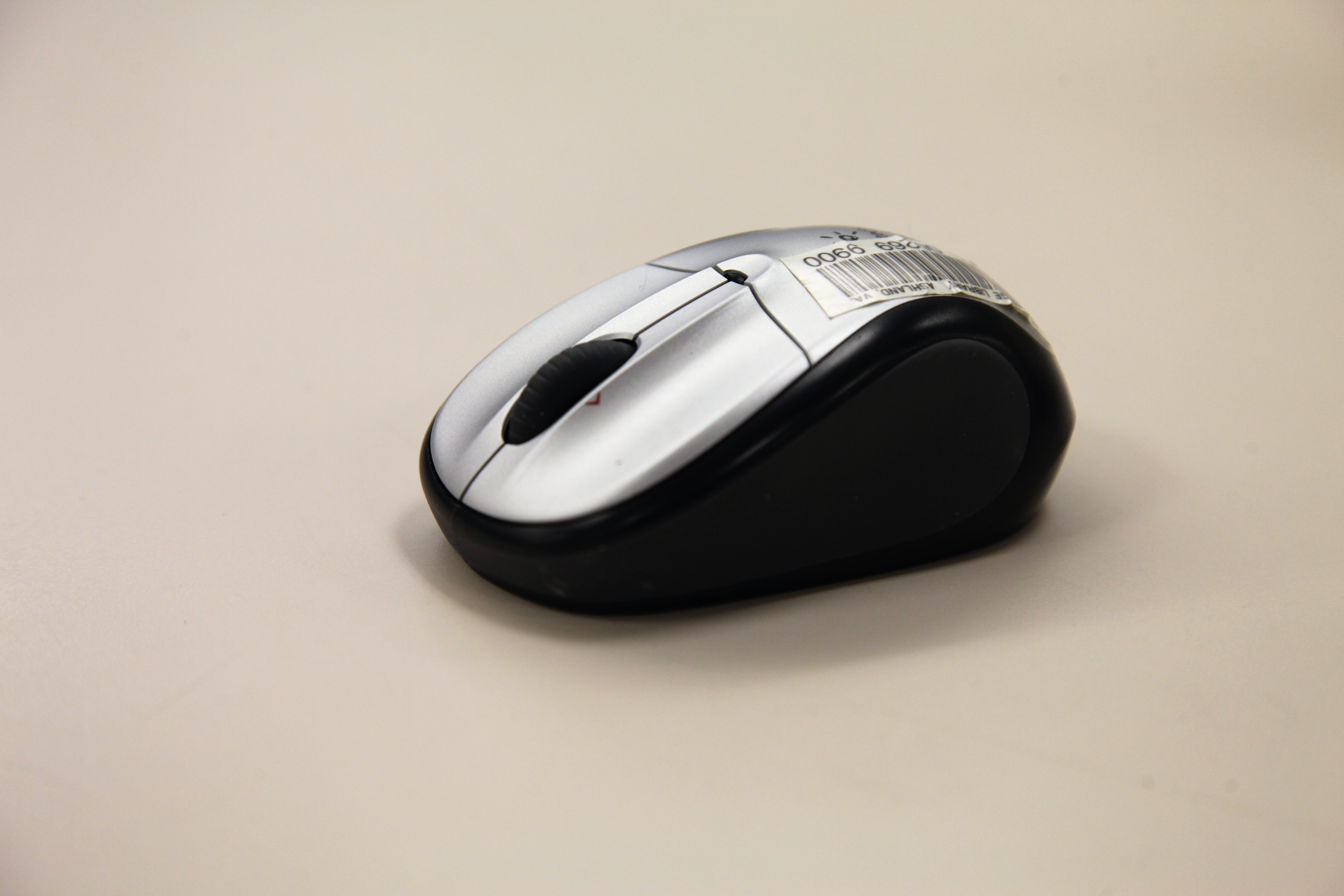 A computer mouse sitting on a counter