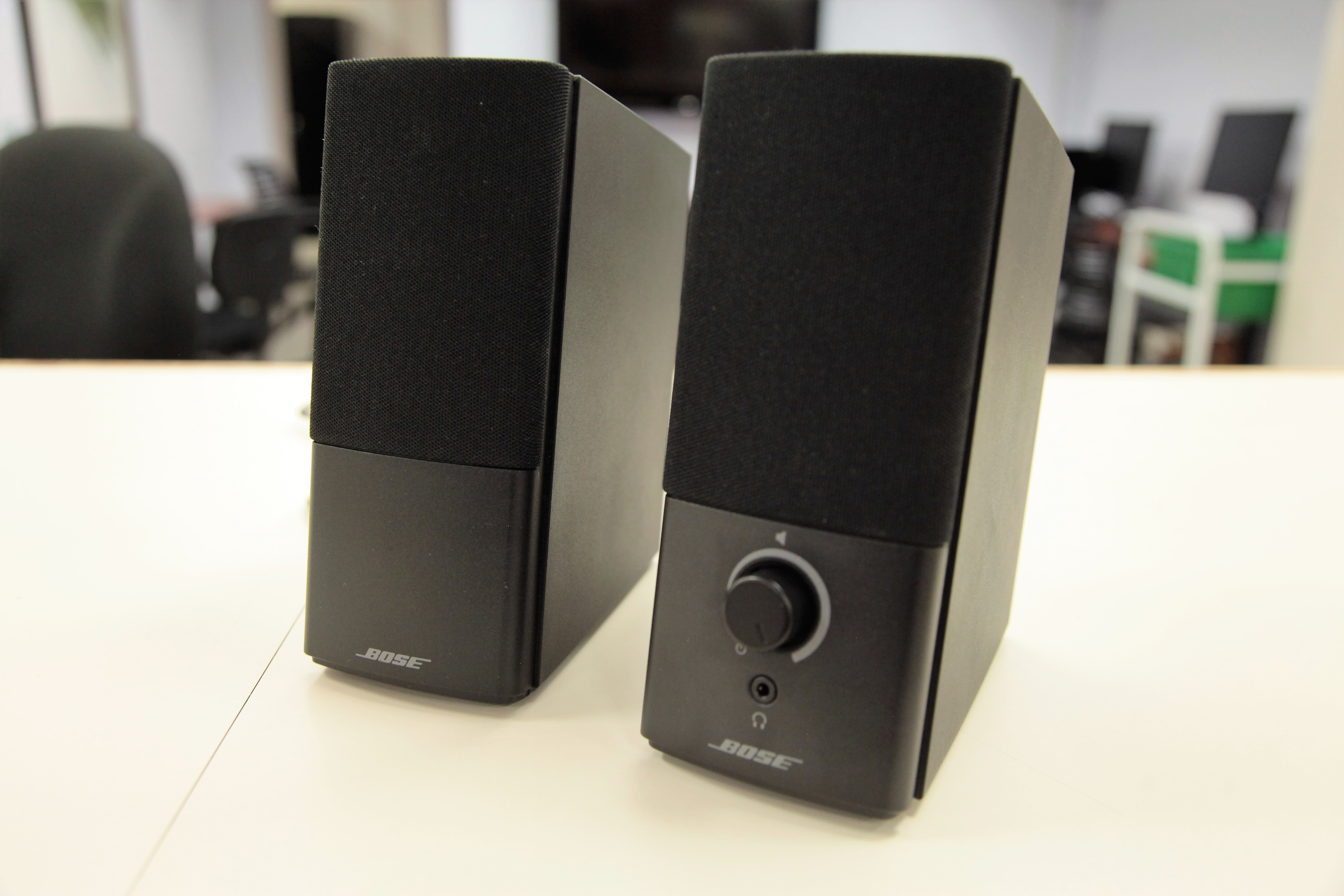 A set of computer speakers on a counter