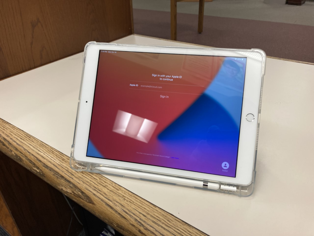 An Apple iPad on a counter, propped up on a stand
