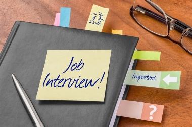 Black portfolio with job interview reminders