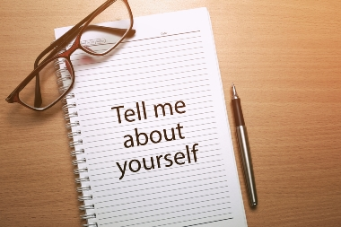 Tell Me About Yourself written on a notebook