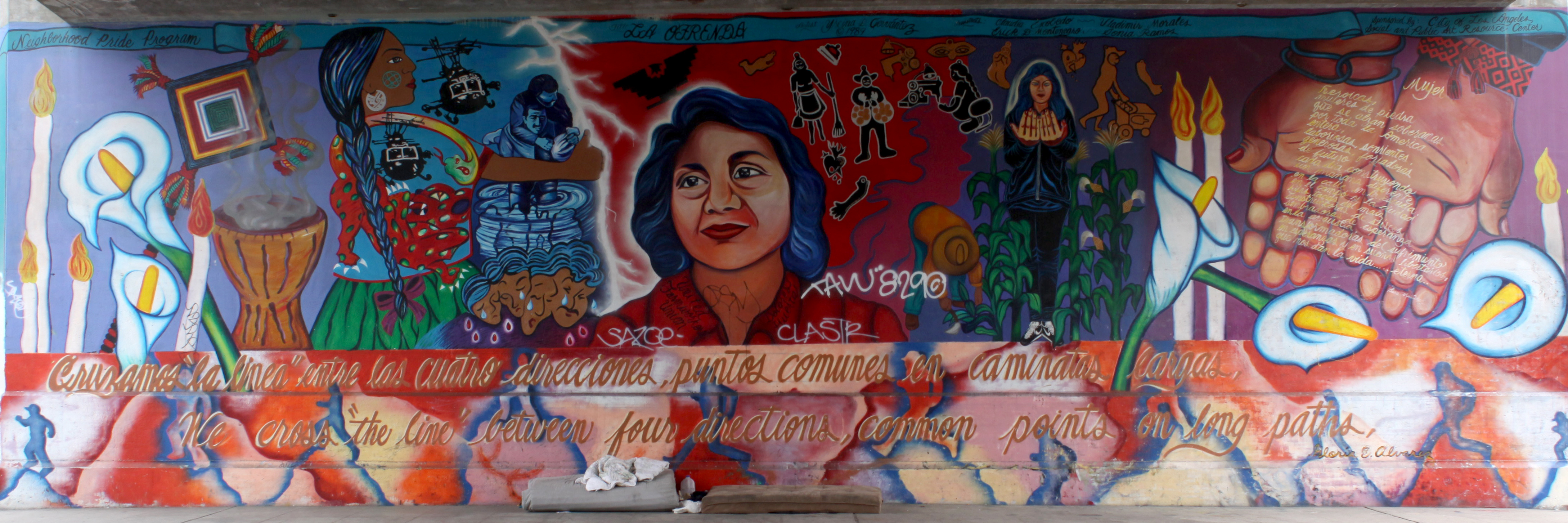 A colorful mural depicting Dolores Huerta and images/symbols associated with her union organizing work