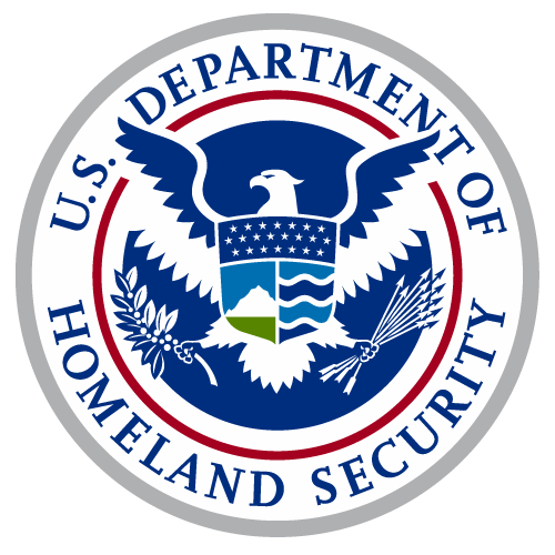 A circular medalion with the Department of Homeland Security Logo in the center surrounded by the agency name. THe