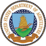 A circular medalion with the USDA seal, which depicts a heap of corn with a hand plow at its base encircled by the agency name.