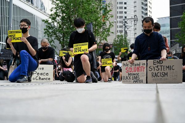 Image Protesters Kneel At Black Lives Matter Rally In Seoul