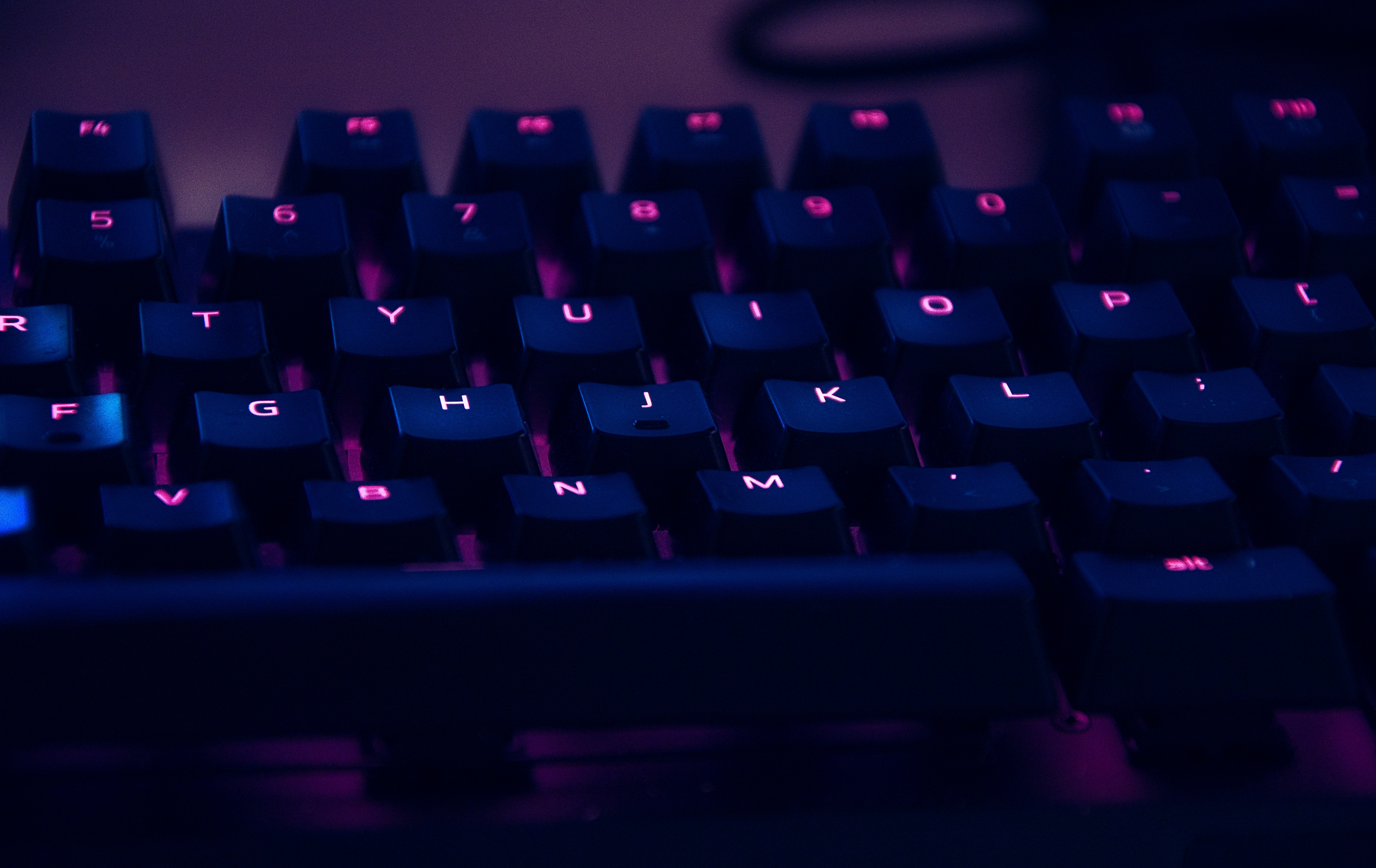 black keyboard with vibrant colored key letters