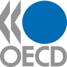 OECD Logo which is a large blue circle with OECD in gray underneath and two less than signs in gray on the left of the blue circle.