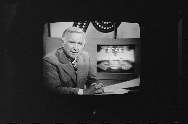 Walter Cronkite on television during the first presidential debate between Ford and Carter.