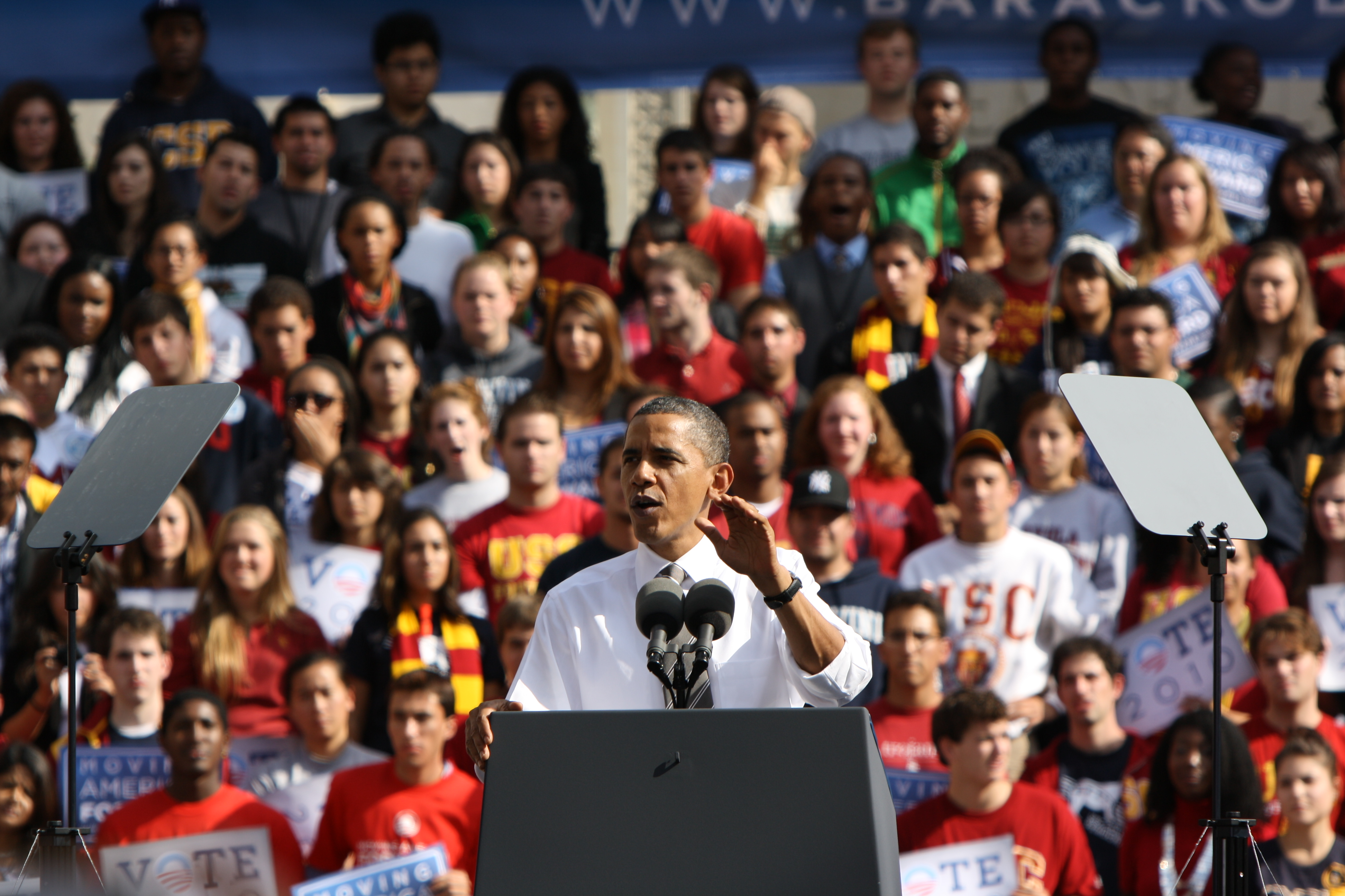 Image of President Obama giving a speech in front of a crowd.
