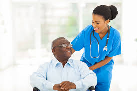 Health care assistant attending a patient