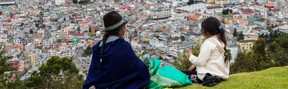 Portrait of indigenous mother and child overlooking Quito, Ecuador.